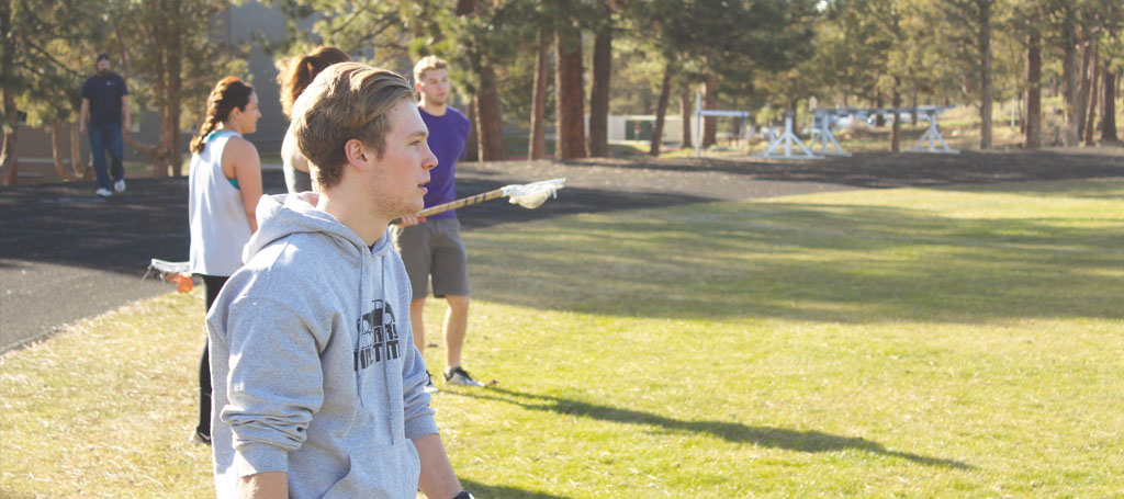 Ryan VanHorn plays lacrosse on the COCC field during one of the first lacrosse practices held at COCC on April 5, 2016.