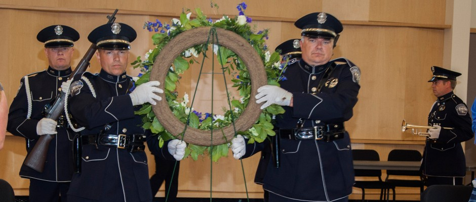 Members of the Bend Police honor Guard present the colors at Central Oregon Community College's annual police week Memorial service. | Photo by Eugene Helmbrecht