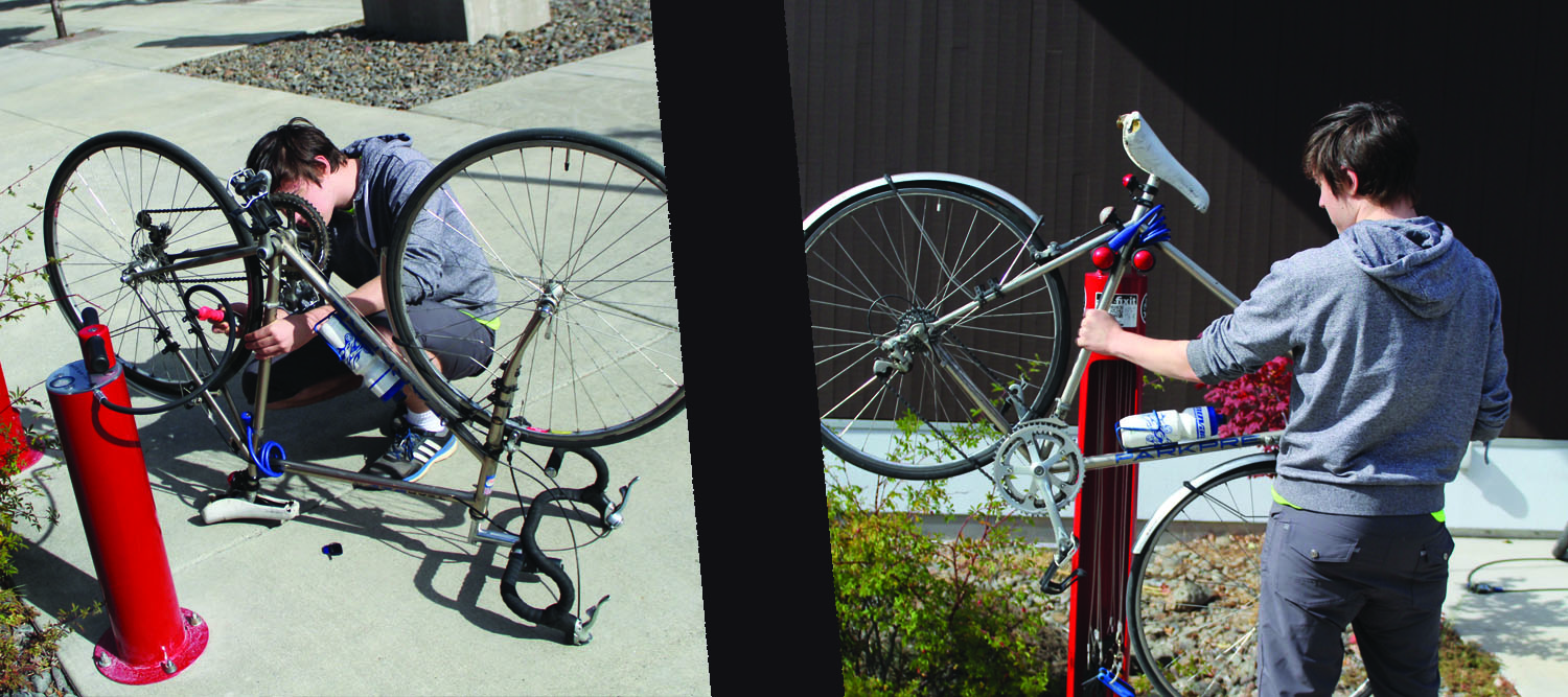 Broadside employee Spencer Light tests out the bike stand and compressed air bike pump before class.