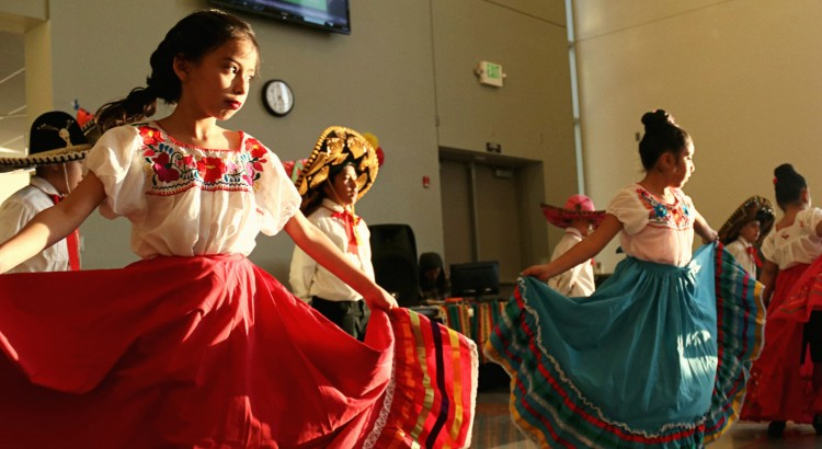 Sage Elementary students end their dance performance with twirling their authentic Latino costumes.
