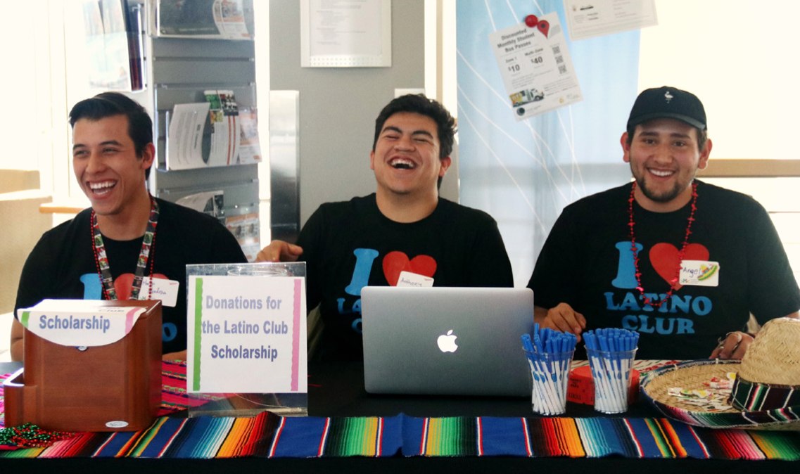Members of the Latino Club greet attendees at the Latino Fiesta. From left to right: Martin Mendoza, Anthony Estrada, and Angel Ortiz.