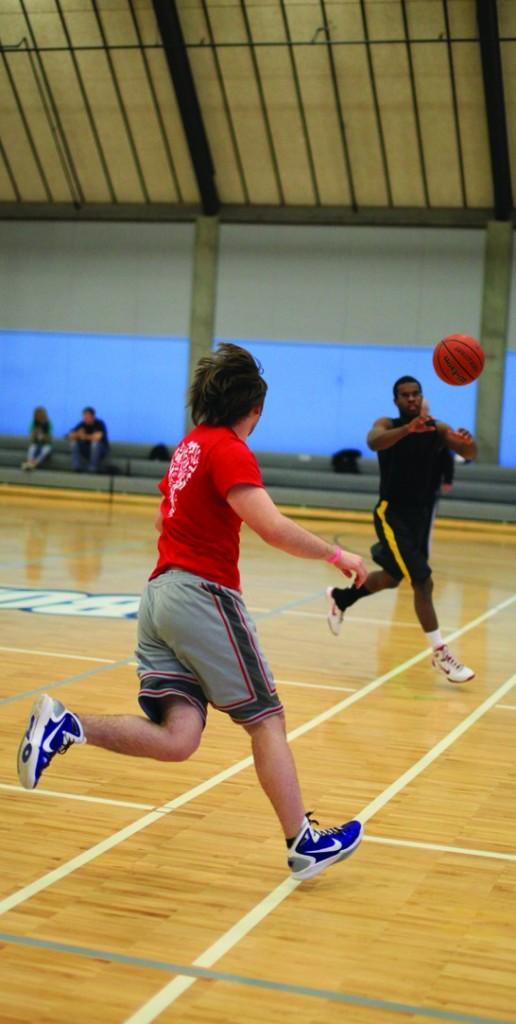 Eric Fox and Donavan Swartout practice drills in basketball class.