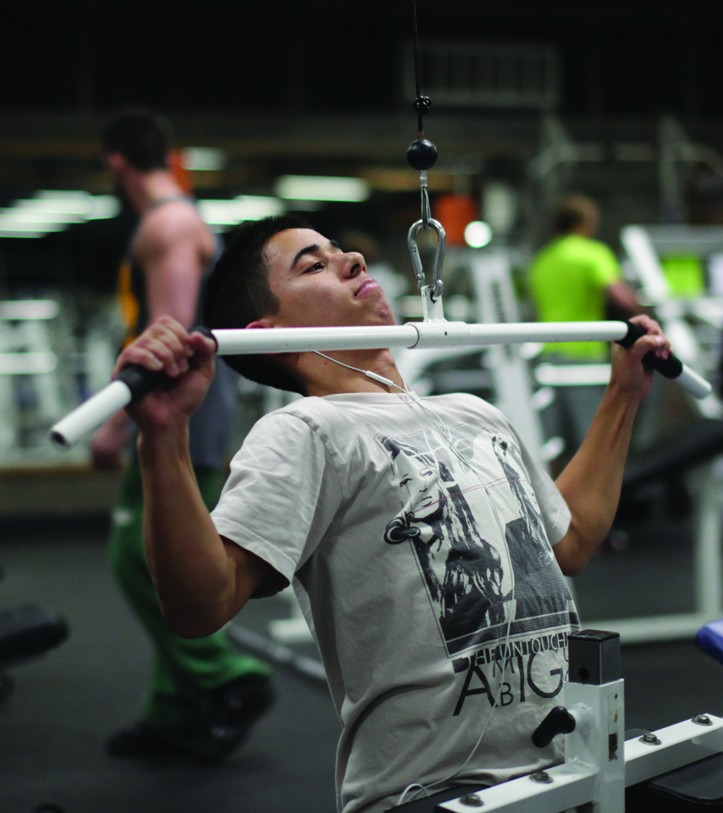 Paul Coduti-Business and Psychology major works on his lats.  Photo by Stephen Badger The Broadside