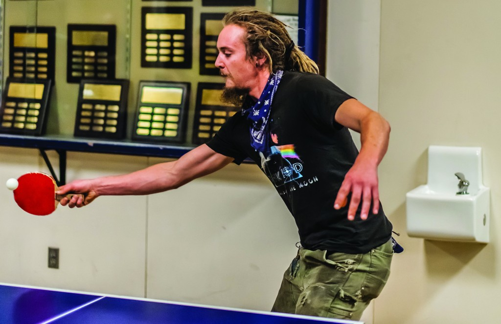 Logan Borg plays a heated game of table tennis. Photo by Stephen Badger The Broadside