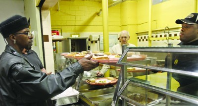 Volunteering at a soup kitchen or homeless shelter is a great way to give back to the community during the holidays.  Photo take from www.mctcampus.com.