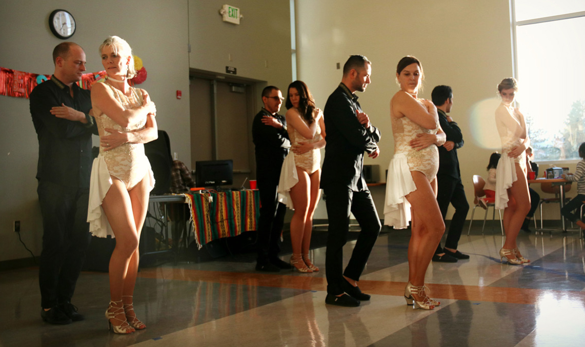 The second dance group from the Latin dance Academy of Bend performs a couples dance.